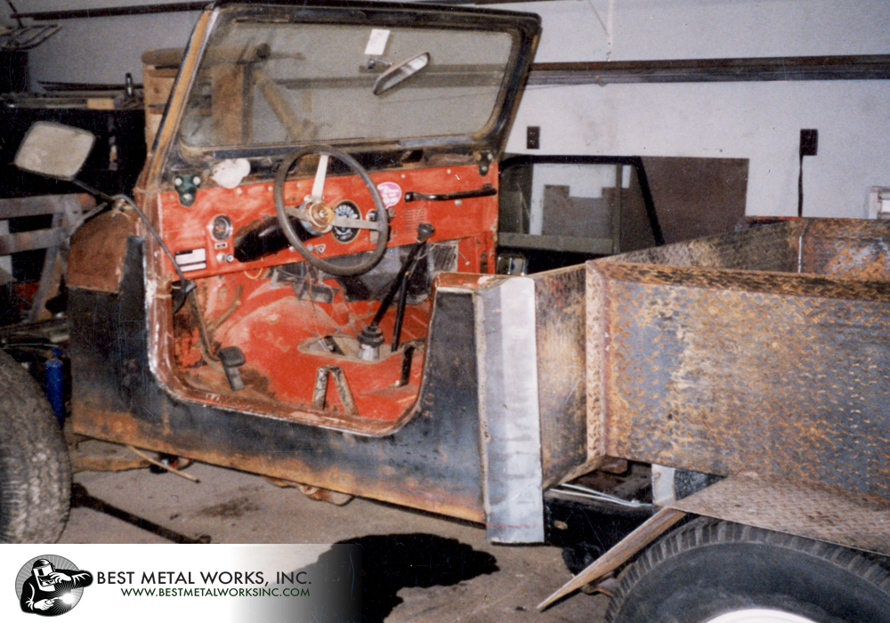 A Jeep Scrambler frame, a rusted CJ 7 tub, and a pile of pieces were converted into a Jeep pickup truck.